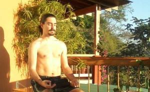 """Ryan meditating in the late afternoon Sun.  """"Om Soom Suryaya Namaha"""""""